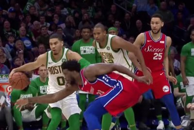 Celtics' Jayson Tatum leaves Joel Embiid in dust with spin move, dunk