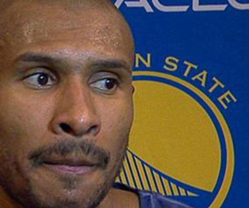 Curry, Golden State Warriors top Phoenix Suns