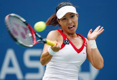 Zheng pulls off Beijing quarterfinal upset