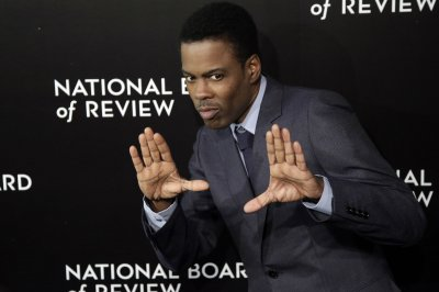 Chris Rock will not back out of hosting the Oscars, says producer