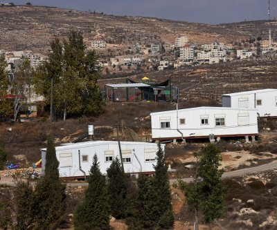 Bill to legalize West Bank settlements moves through Israel's Knesset