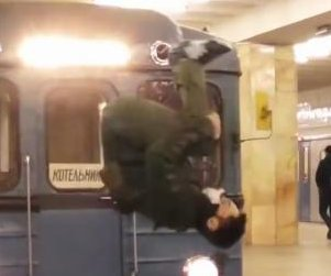 Viral video purports to show daredevil flipping in front of moving train