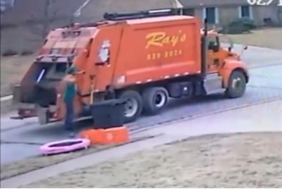 Garbage man's trampoline break caught on camera
