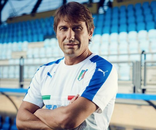Chelsea hires Italy's Antonio Conte as manager
