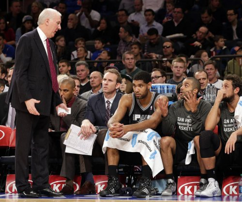 Gregg Popovich sports Tim Duncan shirt while gushing over star