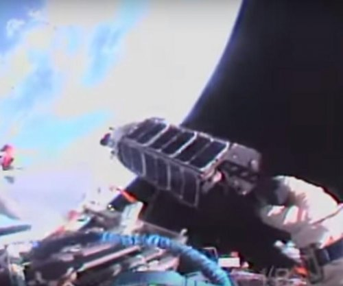 Cosmonauts launch 3D-printed satellite from space station