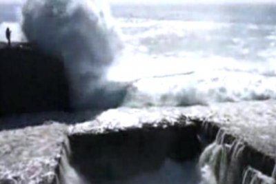 Video shows tourist carried off cliff by giant wave in Ireland