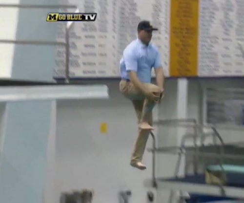 Jim Harbaugh: Michigan coach does can opener dive into pool while wearing khakis