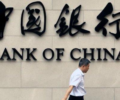 Weak Chinese data leads to Dow, Nasdaq plunge