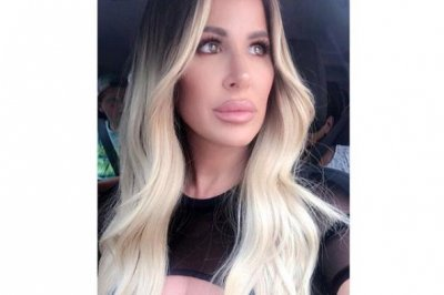 Kim Zolciak plans to get smaller breast implants