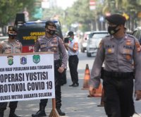 Jakarta governor tests positive for COVID-19 as Indonesia cases rise