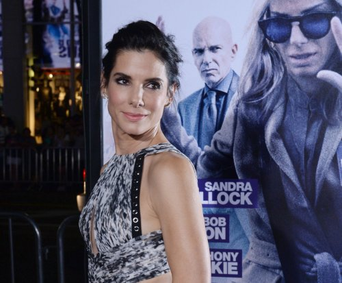 Sandra Bullock, beau Bryan Randall make red carpet debut