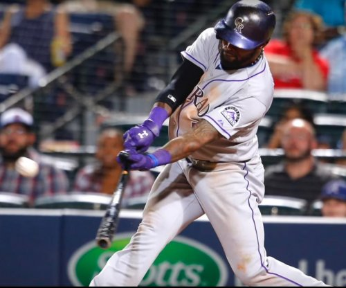 Colorado Rockies' Jose Reyes on paid leave while awaiting trial