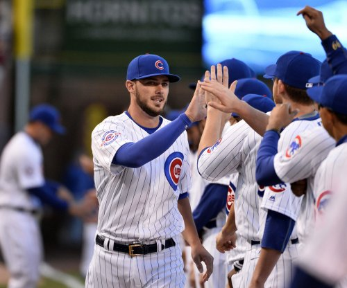 Chicago Cubs' Kris Bryant leaves with ankle injury