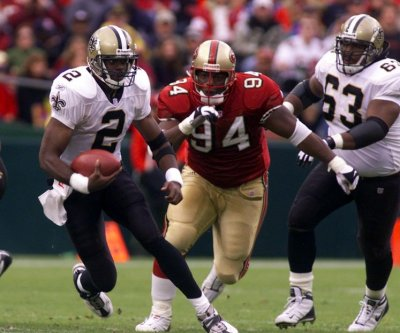 Former NFL star Dana Stubblefield charged with raping disabled woman