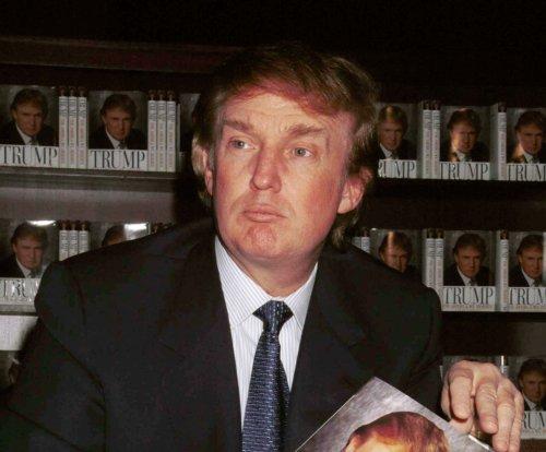 Donald Trump denies report he posed as his own PR man