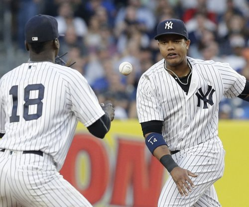 Starlin Castro's slam powers New York Yankees past Cleveland Indians 13-7