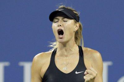 Sharapova, Kvitova ease into 3rd round in Madrid