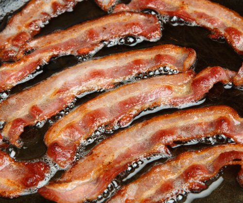 Police bust Bacon in breakfast sausage scuffle