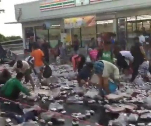 Beer spill causes chaos on Thailand street