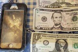 Scuba instructor finds phone, wallet lost in reservoir two years earlier