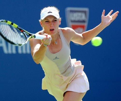 Serena Williams, Caroline Wozniacki reach third round in Madrid