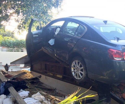 Car spins out of control, lands on roof of California home
