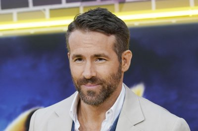 Ryan Reynolds shares photos from COVID-19 nasal swab