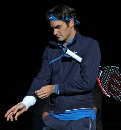 Federer cruises at Paris; Tsonga wins epic