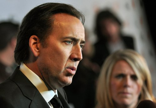 Nicolas Cage rocks a Nicholas Cage shirt at a Guns N' Roses show