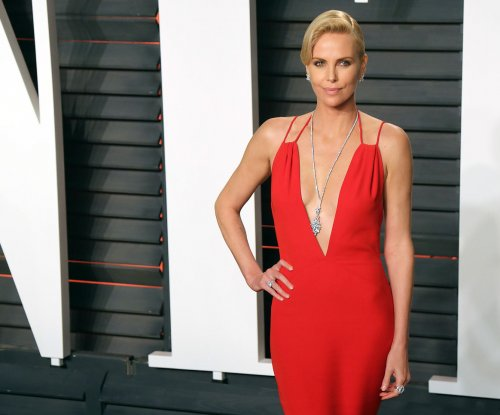 Charlize Theron: 'Women wilt, men age like fine wine'