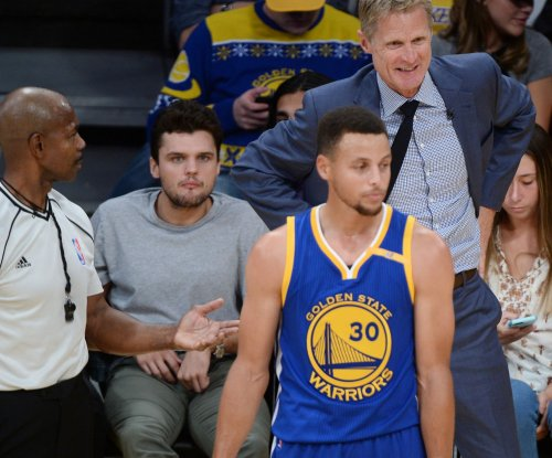 Kevin Durant, Steph Curry carry Golden State Warriors past Denver Nuggets