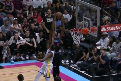 Heat's Bam Adebayo floats over Warriors' Kevin Durant for alley-oop slam