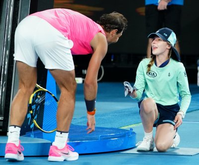 Australian Open: Rafael Nadal hits ballgirl on head with shot, gives her kiss