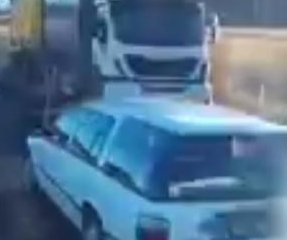 Truck driver captures passing car's harrowing close-call with oncoming semi