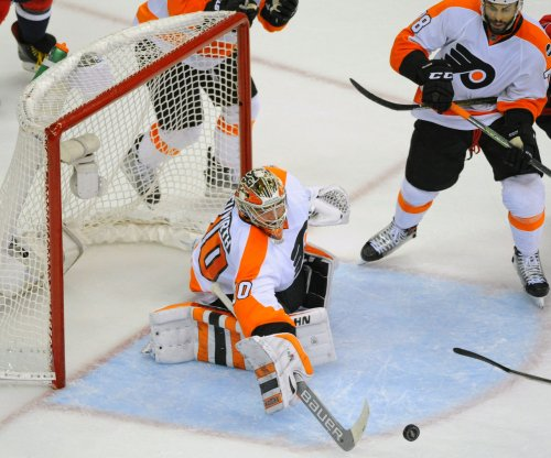 WATCH: Philadelphia Flyers G Michal Neuvirth awake, alert after collapsing on ice