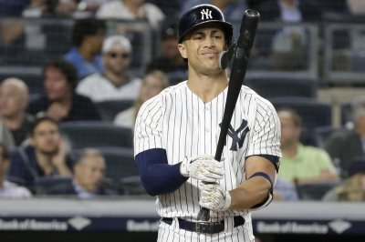 Yankees host Orioles, turn attention toward wild card