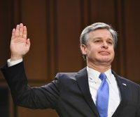 FBI director testifies about Capitol attack, months after warning of extremism