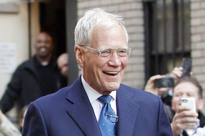 David Letterman shocks with bald head and beard