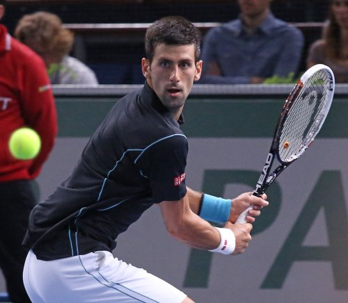 Djokovic gets opening call for Serbia in Davis Cup final