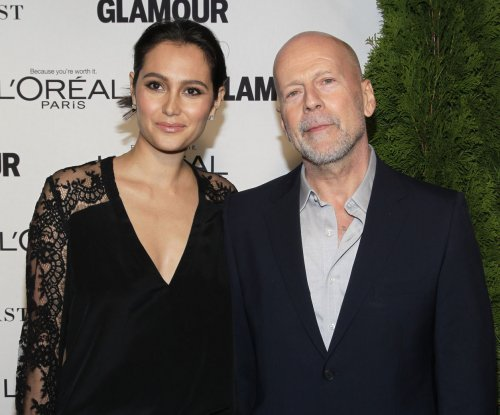 Bruce Willis enjoys family trip to Disneyland with wife and four daughters