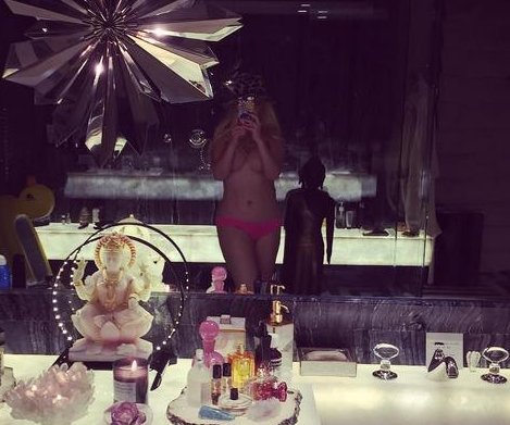 Christina Aguilera shares topless photo: 'It's all real'