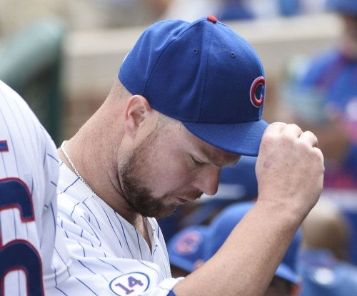 Jon Lester pitches Chicago Cubs past Cincinnati Reds