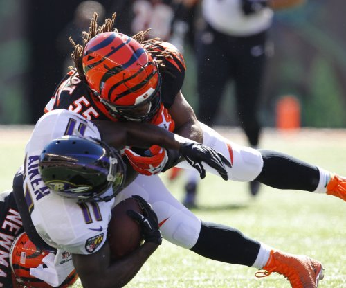Cincinnati Bengals' Vontaze Burfict travels west to get knee examined