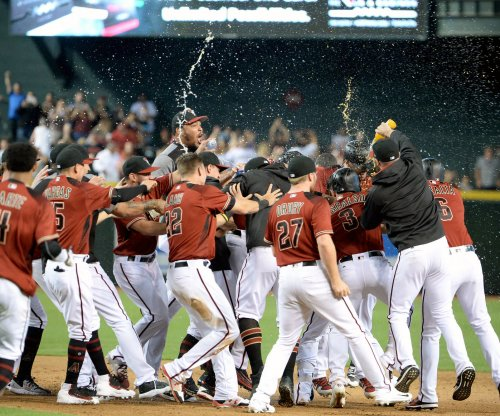 Arizona Diamondbacks beat Miami Marlins, clinch top MLB wild-card spot
