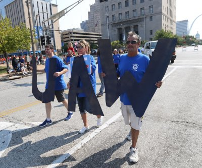 UAW approves increased pay for striking General Motors, Aramark workers