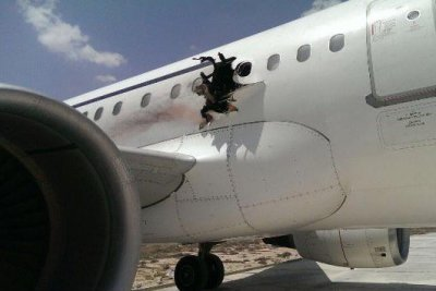 Plane with gaping hole makes emergency landing in Somalia