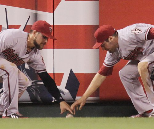 Arizona Diamondbacks' A.J. Pollock fractures elbow on headfirst slide