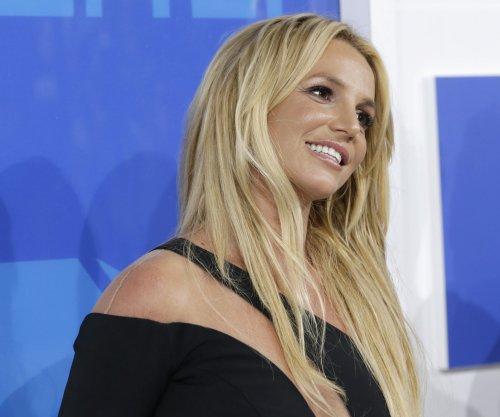 Britney Spears performs through wardrobe malfunction