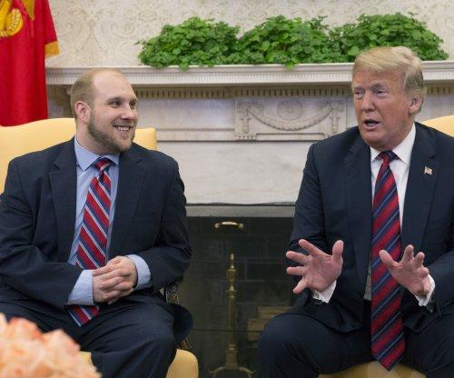 Trump welcomes home 'overwhelmed' prisoner held in Venezuela